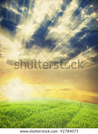 Paper texture. Green field with sunset in grunge and retro style - stock photo