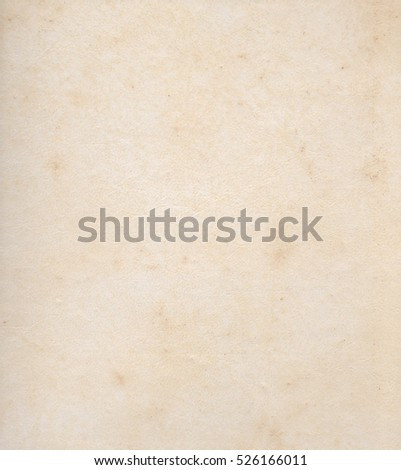 Paper texture light rough textured spotted blank copy space background in beige, yellow, brown