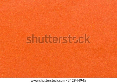 Paper texture - orange kraft sheet background. - stock photo
