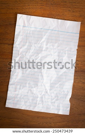 Paper textures on wood background