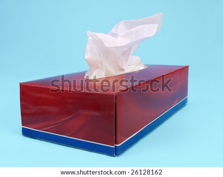 Paper tissue box over light blue background - stock photo