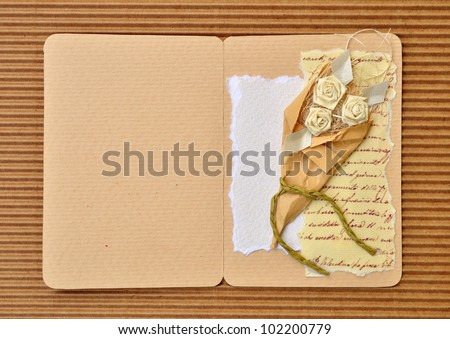 Paper wedding or invitation card decorated with rose flower bouquet design - stock photo