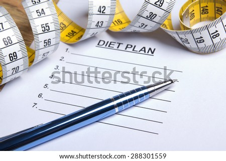paper with diet plan, pen and yellow measure tape - stock photo