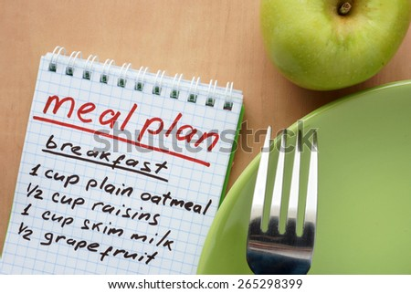 Paper with meal plan and  apple. Diet concept. - stock photo