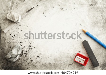 Paper with Pencil, Eraser, Charcoal, Smudges, Messy Marks and Copy Space. - stock photo