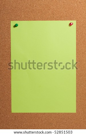 Paper with push pins on cork board. Closeup. - stock photo