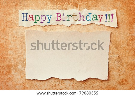 Paper with ripped edges on grunge paper background. Happy birthday card - stock photo