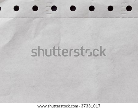 paper with small black holes - stock photo