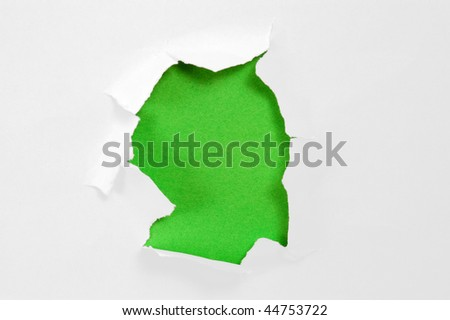Paper with torn hole - stock photo