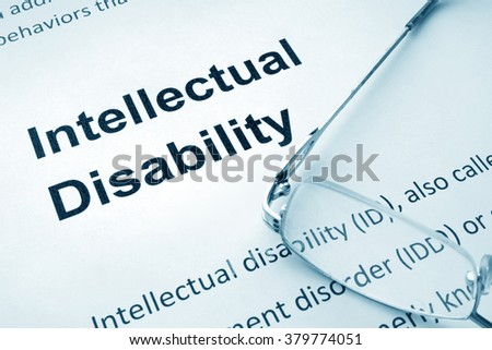 Paper with words  Intellectual Disability and glasses.