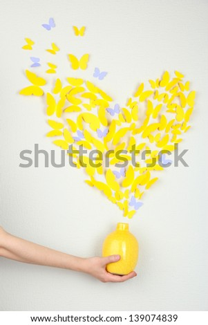 Paper yellow butterfly in form of heart fly out vase