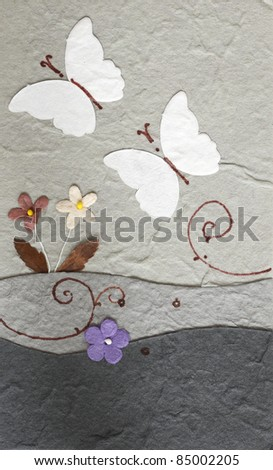 papercraft butterfly with flower in grey background , my handmade - stock photo