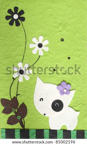 papercraft Dog with flower in green background , my handmade - stock photo