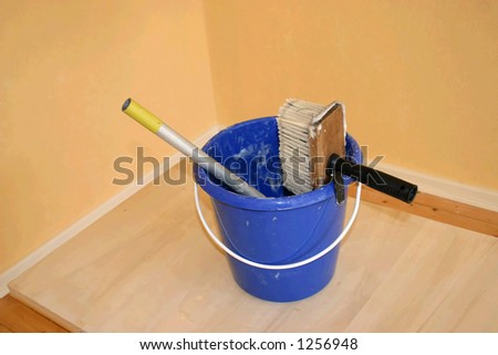 papering the wall - stock photo