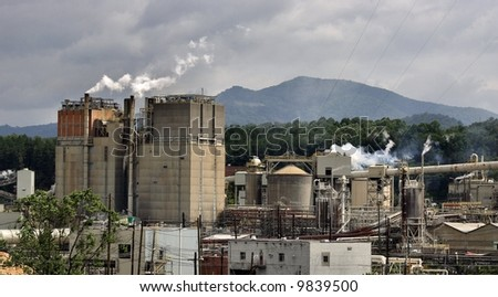 Papermill and Mountains - stock photo