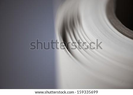 Paperroll in a printshop, copyshop - stock photo