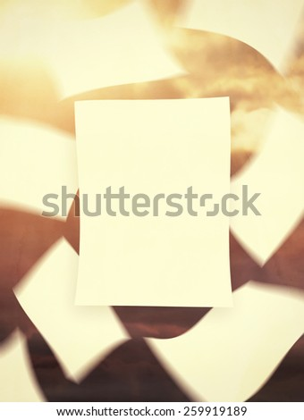 Papers floating in the wind, vintage toned with weathered paper texture overlay - stock photo