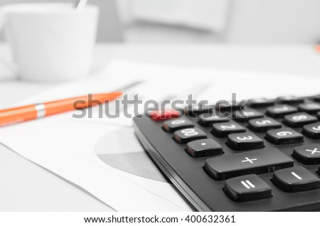 Papers with graphs calculator and Business Growth concept.