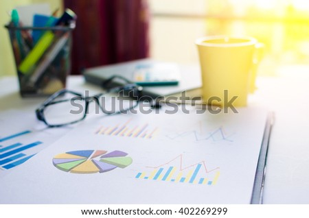 Papers with graphs, calculator. Finance concept. - stock photo