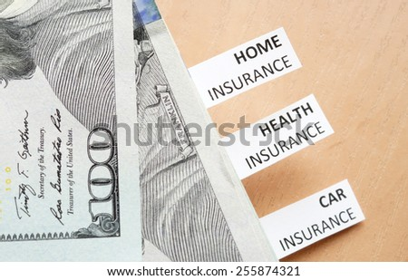 Papers with words Health, car, home insurance and money.  - stock photo