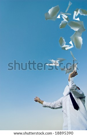 paperwork businessman throws up his papers - stock photo
