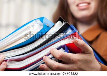 Paperwork - human hand holding business paper file - stock photo