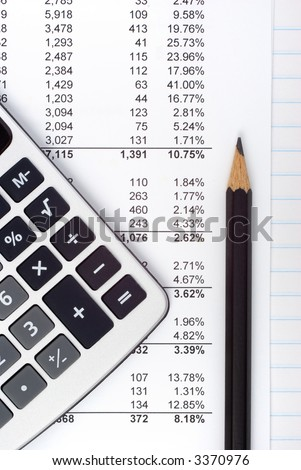 Paperwork with long lines of figures, a calculator and freshly sharpened pencil. Concepts of doing the math, tax, accounts,homework,checking prices, calculating pricing,