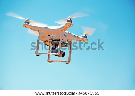 Paphos District, Cyprus - JULY 19, 2015: DJI Phantom 3 drone. Low angle view of drone with camera flying against the sky - stock photo