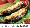 Papoutsakia-Eggplants stuffed with minced meat and topped with cream. - stock