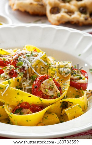 Pappardelle pasta with tomato and herbs - stock photo