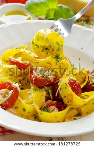 Pappardelle pasta with tomatoes  and herbs - stock photo