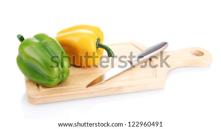 paprika and knife on wooden cutting board isolated on white