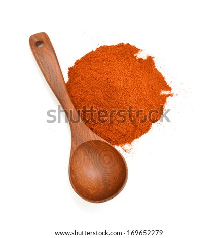 Paprika ground and wooden spoon on white background. Used to color rices, stews, and soups, meats.  - stock photo