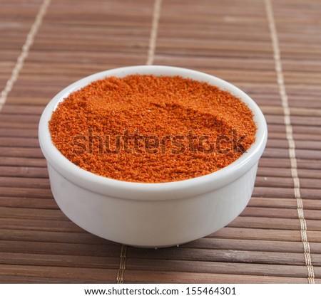Paprika ground in a white bowl  - stock photo