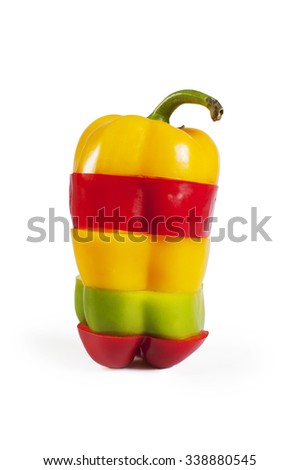 Paprika sliced isolated on white - red, yellow and green paprika mix - stock photo