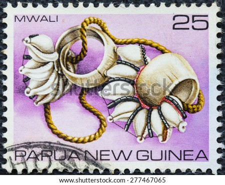 PAPUA NEW GUINEA - CIRCA 1979 : A stamp printed in Papua New Guinea shows Mwali (Armshell), circa 1979 - stock photo