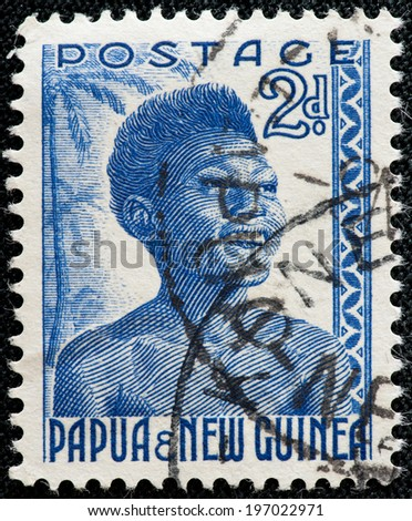 PAPUA NEW GUINEA - CIRCA 1952: A used postage stamp from Papua New Guinea illustrating an indigenous woman, issued in 1952. - stock photo