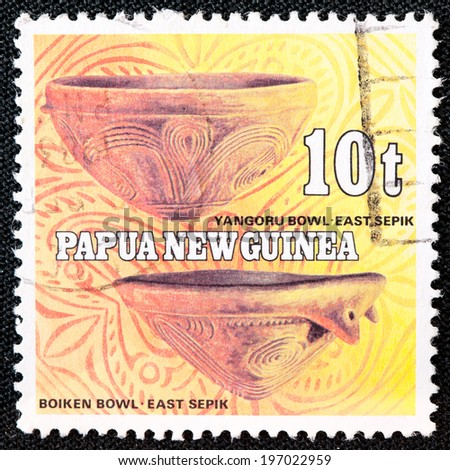 PAPUA NEW GUINEA - CIRCA 1982: A used postage stamp from Papua New Guinea illustrating Native Pottery, issued in 1982. - stock photo