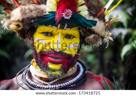 PAPUA NEW GUINEA - OCTOBER 30: The men of the Huli tribe in Tari area of Papua New Guinea in traditional clothes and face paint on October 30, 2013.  - stock photo
