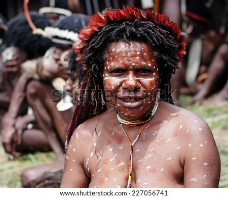 PAPUA PROVINCE, INDONESIA -DEC 28: The woman of a Papuan tribe in traditional clothes and coloring at New Guinea Island, Indonesia on Dec 28, 2010  - stock photo