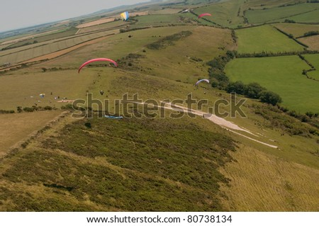 para gliders soaring over weymouth - stock photo