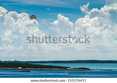 Para-sailing in CocoCay in Bahamas. - stock photo