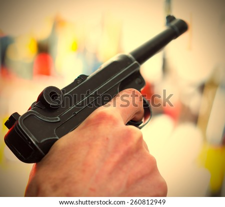 Parabellum automatic pistol in a human hand, shallow depth of field. close-up. instagram image retro style - stock photo
