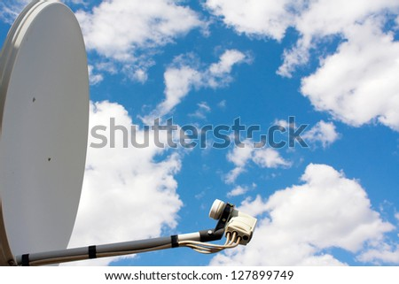 Parabolic aerial on a background sky