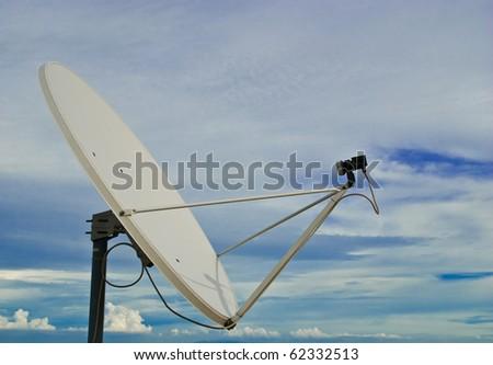 parabolic antenna on a background of sky - stock photo