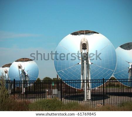 parabolic dish solar energy collector - stock photo