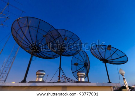 Parabolic satellite antennas with blue night background
