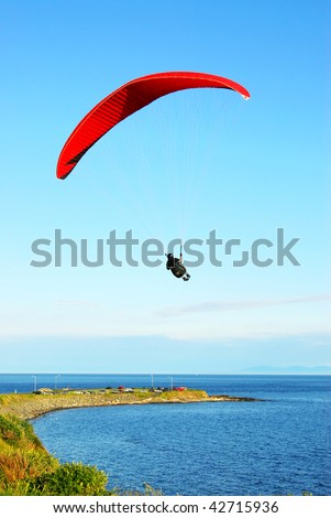 parachute flying above the ocean, victoria, british columbia, canada