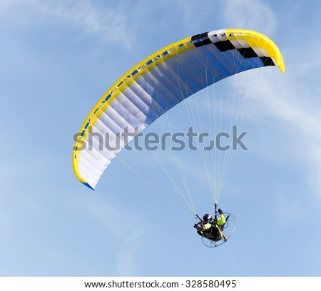 parachute flying in the sky - stock photo