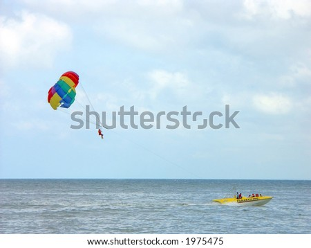 Parachute surfer being hauled by a motorboat